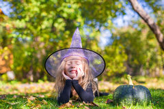 Cute little girl in Halloween costume with jack Royalty Free Stock Photo