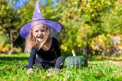 Cute little girl in Halloween which costume have Stock Photo