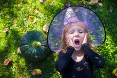 Cute little girl in Halloween which costume have Stock Photography