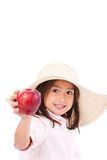 Cute little girl, hand holding red apple with text space Stock Photos