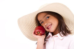 Cute little girl, hand holding red apple Stock Image