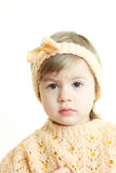 Cute little girl in handmade clothes. Portrait of little girl wearing warm handmade clothes Royalty Free Stock Photos
