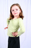 Cute little girl with hands. On hips Stock Photography