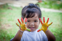 Cute little girl with hands painted Stock Image
