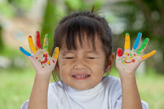Cute little girl with hands painted Stock Photos