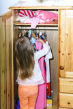Cute little girl hanging up her clothes Royalty Free Stock Images
