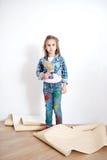 Cute little girl hanging wallpaper Stock Photo