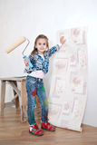 Cute little girl hanging wallpaper Royalty Free Stock Photos