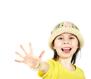 Cute little girl happily shows an open hand Royalty Free Stock Photo