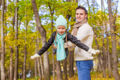 Cute little girl with happy dad enjoy their autumn Stock Photos