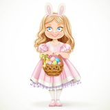 Cute little girl with hare ears on her head holding a basket with Easter eggs Stock Photography