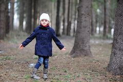 Cute little girl has fun in spring forest Royalty Free Stock Image