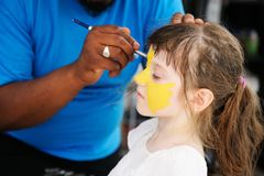Cute little girl has her face painted Royalty Free Stock Photo