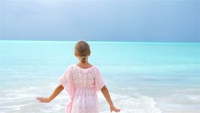 Adorable little girl on tropical beach stock video footage
