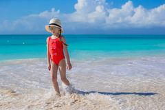 Cute little girl in hat at beach during caribbean vacation Stock Photography