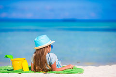 Cute little girl in hat with beach toys during royalty free stock images