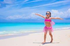 Cute little girl have fun on beach summer vacation Stock Photo