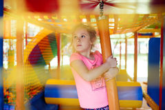 Cute little girl have fun at soft outdoor playground.  Royalty Free Stock Photography
