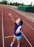 Cute little girl. Little girl have fun on the stadium royalty free stock image