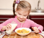 Cute little girl having breakfast cereals Royalty Free Stock Images
