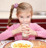 Cute little girl having breakfast drinking milk Royalty Free Stock Image