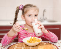 Cute little girl having breakfast drinking milk Royalty Free Stock Images