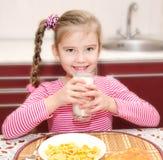 Cute little girl having breakfast drinking milk Stock Photography