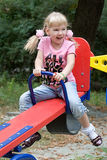 Cute little girl having fun. Stock Photos