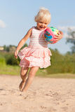 Cute little girl having fun on beach Stock Photography