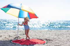 Cute little girl under a colourful umbrella. royalty free stock photos