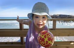 Cute little girl having fun on the beach Stock Photography