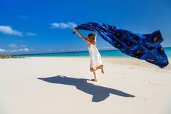 Cute little girl having fun on beach vacation Stock Image