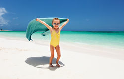 Cute little girl having fun on beach vacation Stock Photos