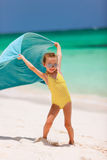 Cute little girl having fun on beach vacation Royalty Free Stock Photos