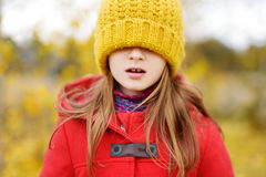 Cute little girl having fun on beautiful autumn day Stock Photo