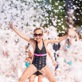 Cute little girl having fun at foam party. Royalty Free Stock Photo