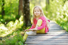 Cute little girl having fun during forest hike on beautiful summer day Royalty Free Stock Photos