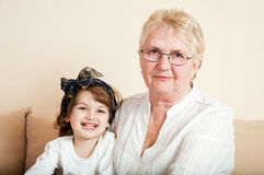 Cute little girl having fun with grandma Royalty Free Stock Photos