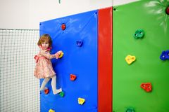 Cute toddler girl having fun in indoor leisure center for kids Royalty Free Stock Image