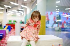 Cute toddler girl having fun in indoor leisure center for kids. Royalty Free Stock Image