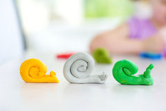 Cute little girl having fun with modeling clay at a daycare. Creative kid molding at home. Royalty Free Stock Photo