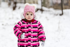 Cute little girl having fun outdoor on nature at winter. Stock Images