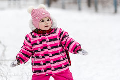 Cute little girl having fun outdoor on nature at winter. Royalty Free Stock Photos