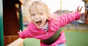 Cute little girl having fun on outdoor playground royalty free stock image