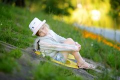 Cute little girl having fun outdoors on sunny summer evening. Child exploring nature. Summer activities for kids stock images