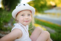 Cute little girl having fun outdoors on sunny summer evening. Child exploring nature. Summer activities for kids royalty free stock images