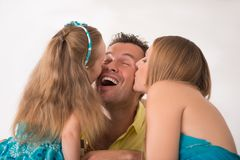 Cute little girl having fun with parents Stock Photos