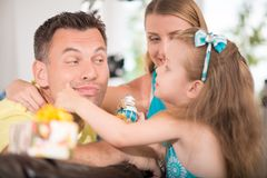 Cute little girl having fun with parents Stock Images