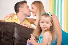 Cute little girl having fun with parents Stock Image