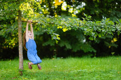 Cute little girl having fun in a park Stock Photography